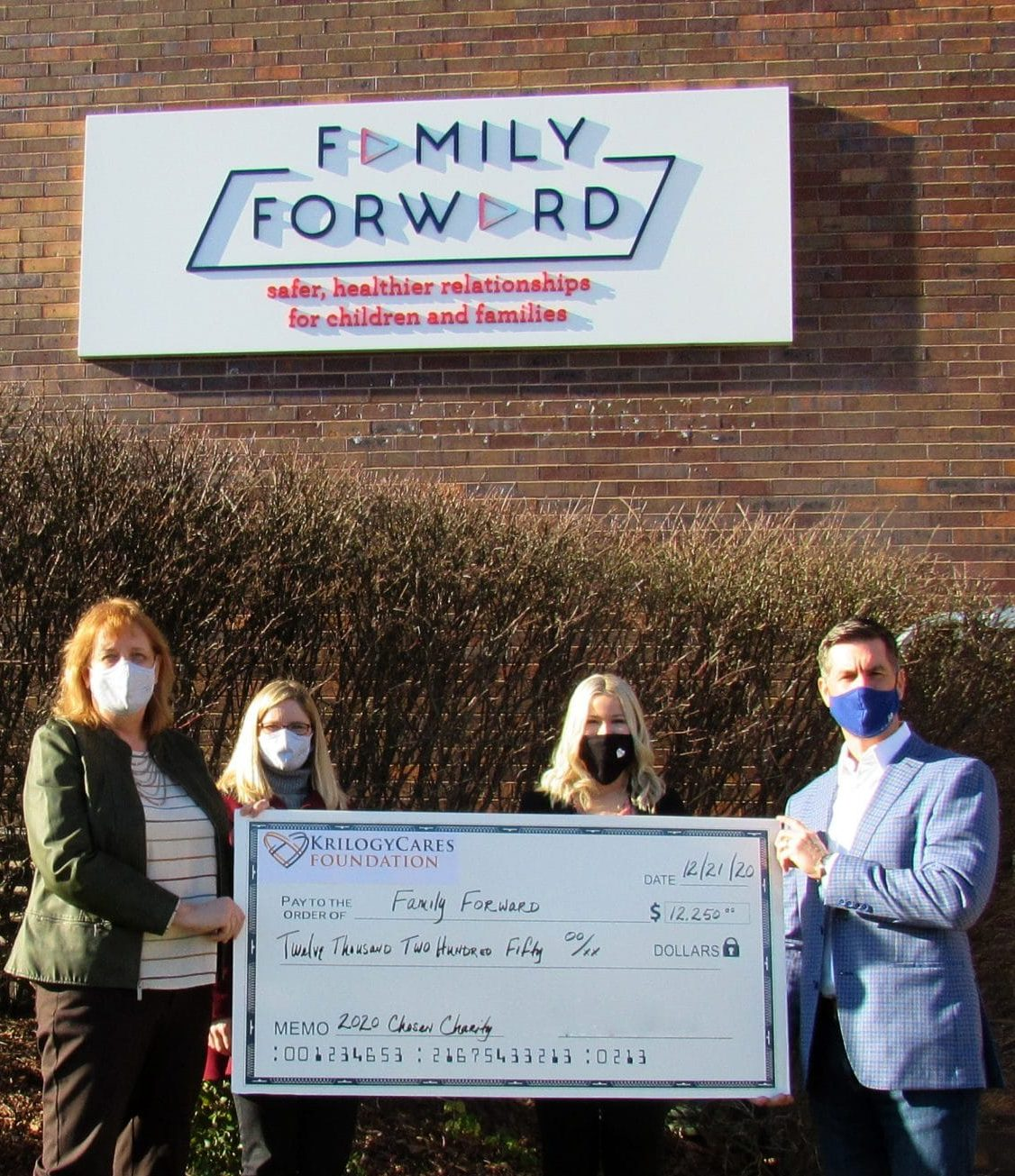 Krilogy presents check to FamilyForward, 2020 Krilogy Cares partner.