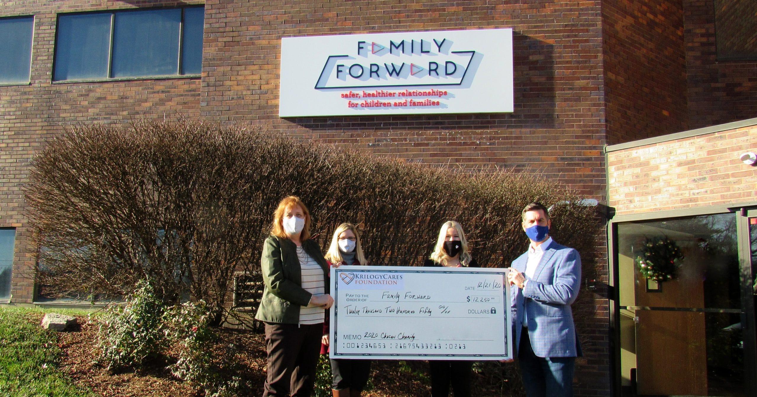 Krilogy presents check to FamilyForward, 2020 Krilogy Cares partner.